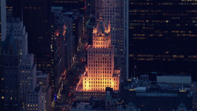 the crown building, located on 5th avenue, in midtown manhattan. the building's decorative forms are illuminated at night. - 1921 stock videos & royalty-free footage