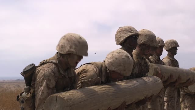 the crucible is a 54hour event that recruits must go through to earn the title of united states marine while training at marine corps recruit depot... - 迷彩柄点の映像素材/bロール