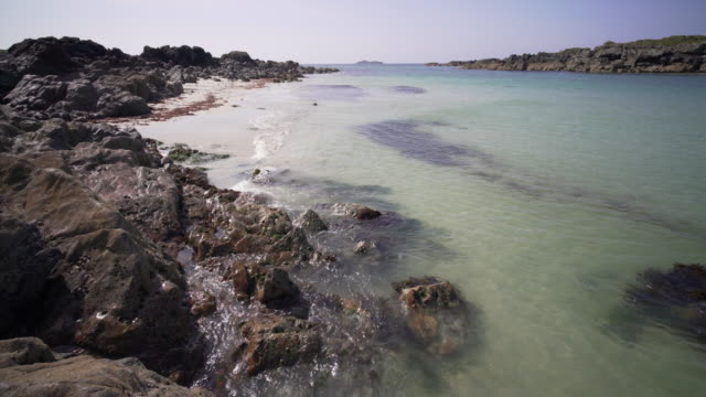the crystal clear blue water and white sandy beaches of iona, scotland - hebrides stock videos & royalty-free footage