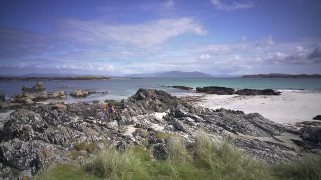 the crystal clear blue waters of iona, scotland. on a clear summer afternoon. - hebrides stock videos & royalty-free footage
