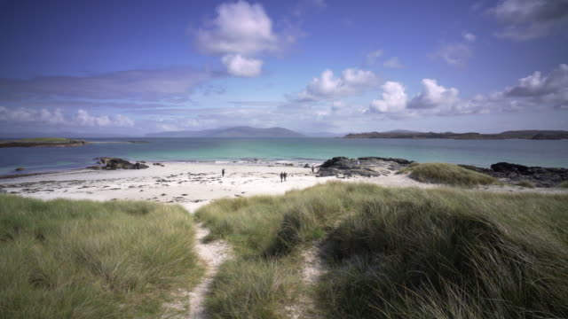 the crystal clear blue waters of iona, scotland. on a clear summer afternoon. - hebrides stock videos and b-roll footage