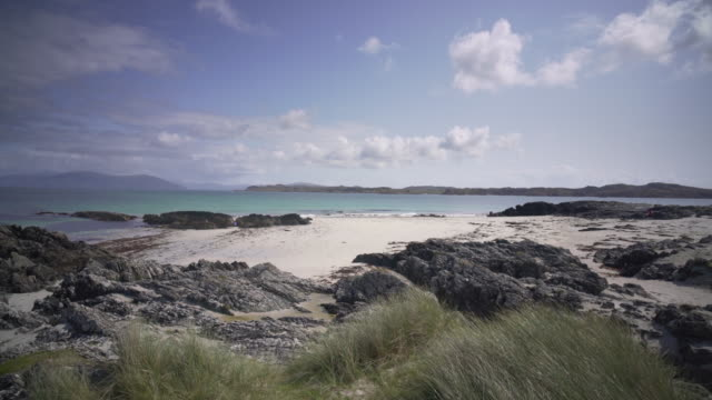 stockvideo's en b-roll-footage met the crystal clear blue waters of iona, scotland. on a clear summer afternoon. - eiland
