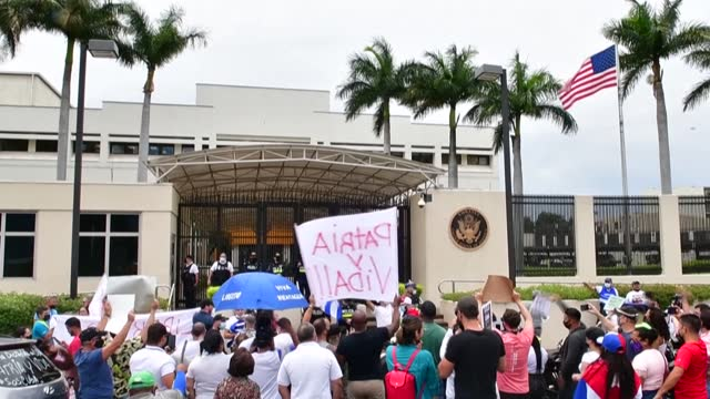 the cuban diaspora in costa rica demonstrates in front of the us embassy in san jose asking for a military and humanitarian intervention in their... - costa rica stock videos & royalty-free footage