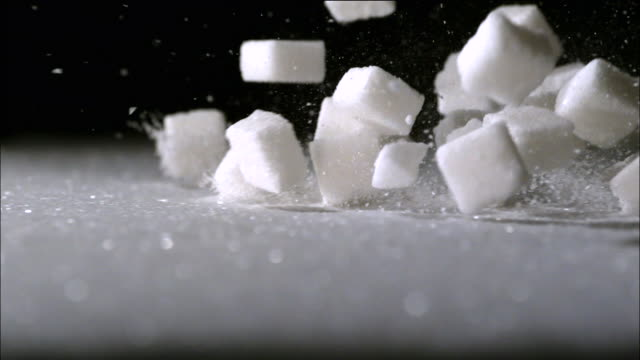 the cube sugar pouring out to the ground - sugar cube stock videos & royalty-free footage