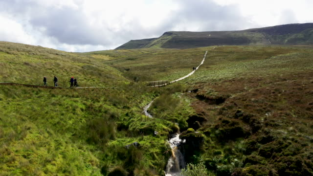 the culicagh mountain boardwalk leads its way close to the summit and highest point in fermanagh, and the actual border between northern ireland and... - northern ireland stock videos & royalty-free footage