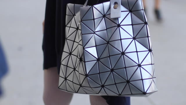 the cult of issey miyake's bao bao tote bag is alive and well outside a new york city fashion show in it's earlier release years and is still going... - short hair stock videos & royalty-free footage