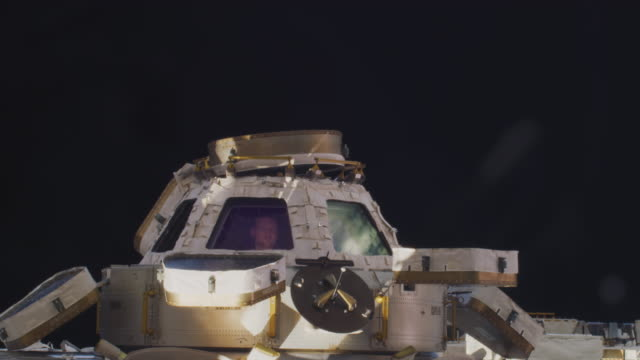 the cupola opens showing an astronaut looking through the windows the mission of expedition 56 began on 1 june 2018 upon the departure of soyuz ms07... - international space station stock videos & royalty-free footage