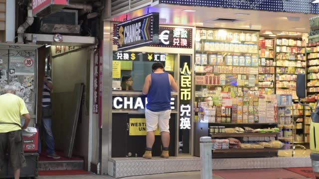 the currency symbols for the chinese yuan the euro and the dollar are displayed at a currency exchange store in hong kong china on wednesday aug 12... - chinese currency stock videos & royalty-free footage