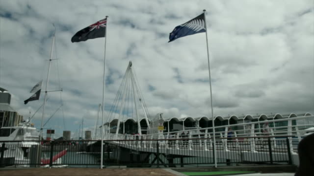The current New Zealand flag flying next to the contending flag prior to the New Zealand flag referendum