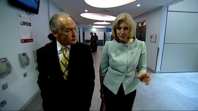 stockvideo's en b-roll-footage met the inside story theresa may theresa may mp interview as she and stewart along corridor together there will be spending cuts but also reforming the... - cut video transition
