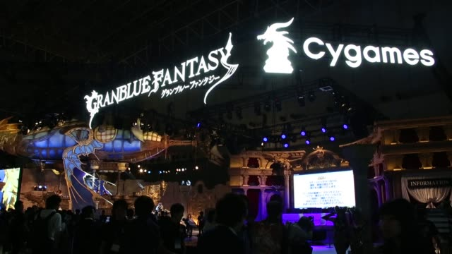 stockvideo's en b-roll-footage met the cygames inc. booth stands at the tokyo game show 2015 at makuhari messe in chiba, japan, on friday, sept. 18, 2015. shots: attendants in cosplay... - television game show