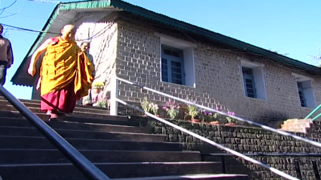 of hh the dalai lama descending steps leading to the tsuglagkhang temple complex. his holiness, the 14th dalai lama, tenzin gyatso, lives in exile in... - traditionally tibetan stock videos & royalty-free footage