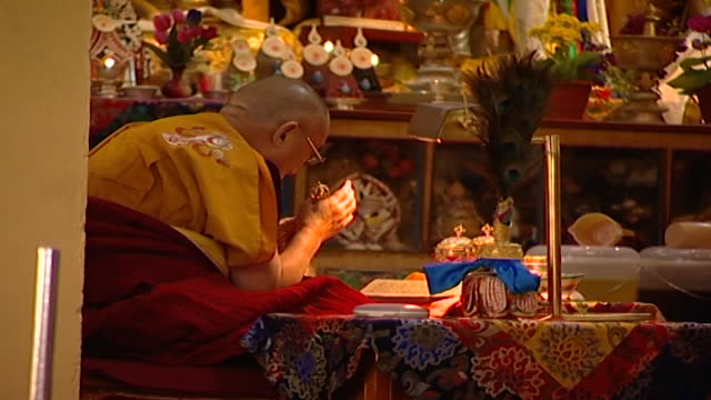 the dalai lama ringing a bell or drilbu while meditating in the tsuglagkhang temple hh the 14th dalai lama tenzin gyatso lives in exile in mcleod ganj - meditating stock videos & royalty-free footage
