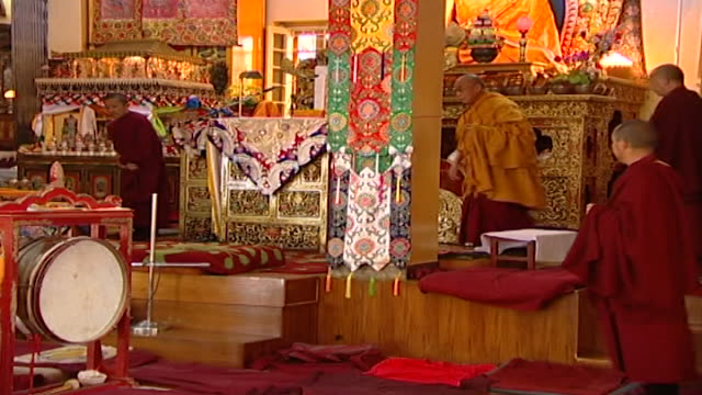 hh the dalai lama sitting behind a column preparing to meditate in the tsuglagkhang temple hh the 14th dalai lama tenzin gyatso lives in exile in... - meditating stock videos & royalty-free footage