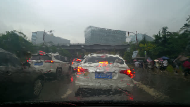 the dalian city traffic jam is seen blurred through a raindrop covered windshield glass. - abstract stock videos & royalty-free footage