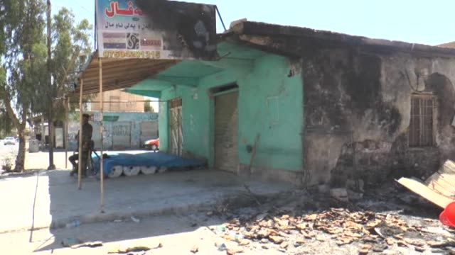 the damaged buildings are seen following peshmerga forces' seizure of makhmur by repelling islamic state formerly known as islamic state of iraq and... - armored vehicle stock videos & royalty-free footage
