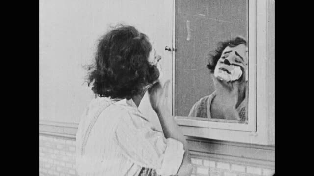 1920 The Daring and Athletic Molly resembles a clown while trying to remove oil from her face