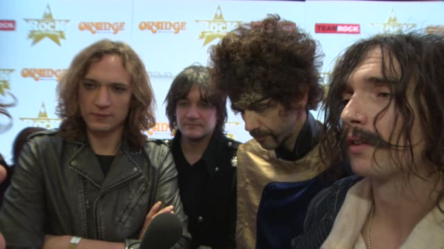 interview the darkness on who they would like to tour with and swimming at classic rock awards 2013 at the roundhouse on november 14 2013 in london... - popular music tour stock videos and b-roll footage