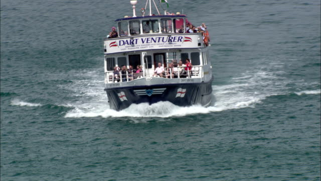 The Dart Venturer cruises near the shore of the southwest coast of England. Available in HD.