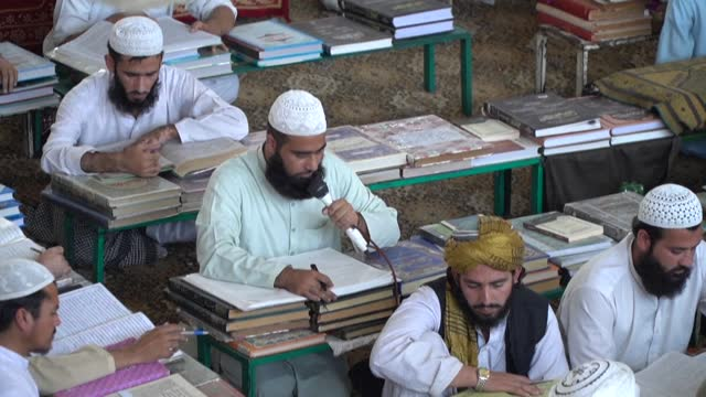 """the darul uloom haqqania seminary in pakistan, which critics have dubbed the """"university of jihad"""", has churned out a who's who of taliban top brass... - rebellion stock videos & royalty-free footage"""
