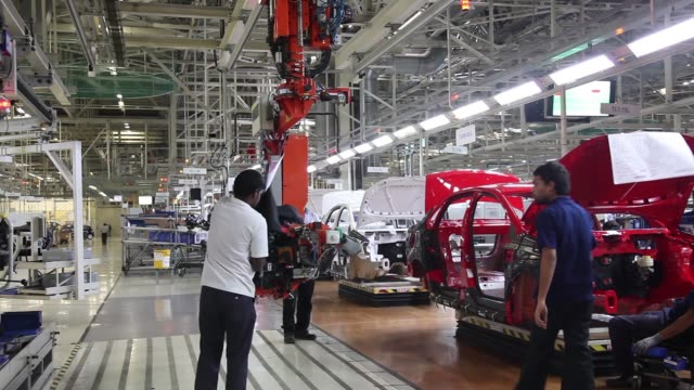 the dashboard a volkswagen ag vento automobile is transported to the production line at the volkswagen india pvt. plant in chakan, maharashtra,... - bumpy stock videos & royalty-free footage