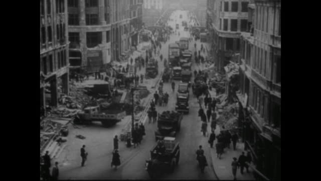 the day after an air raid, the people of london make their way back to work to keep the factories and offices going in spite of the german bombers - world war ii stock videos & royalty-free footage