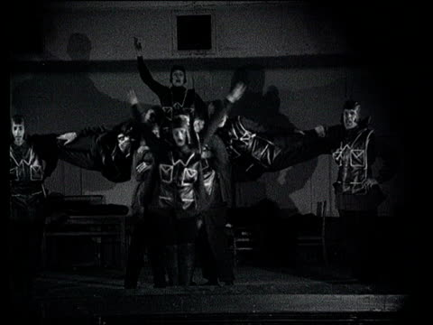 the day before red army 10th anniversary avantgarde propaganda about culture man playing piano man blows his whistle dancers rehearsing for show... - 1928年点の映像素材/bロール
