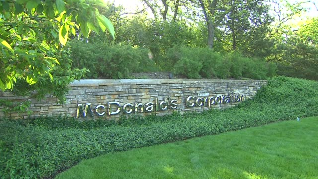 the day before the mcdonald's annual shareholders meeting more than 1000 workers and activists rallied and marched on the corporate headquarters in... - dupage county stock videos & royalty-free footage