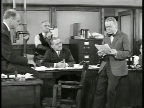 stockvideo's en b-roll-footage met int 'the day' newspaper office w/ editor reading part of woodrow wilson's speech out loud telling them what to put on front page 'wilson calls for... - woodrow wilson