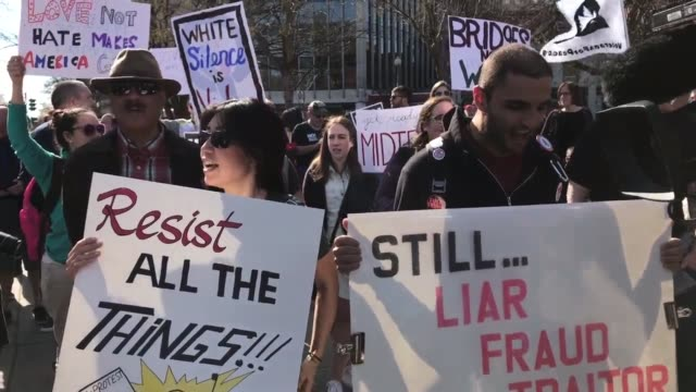 "the dc rally was one of several ""not my presidents day"" protests across the country to mark the presidents day holiday protesters criticized trump's... - presidents day stock videos and b-roll footage"