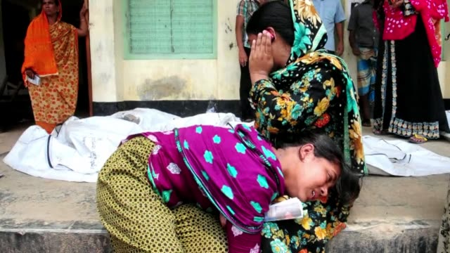 the death toll from the collapse of a garment factory complex in bangladesh rose past 1000 friday as dozens more corpses were found stacked in a... - garment stock videos & royalty-free footage