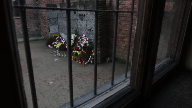 the death wall were prisoners were shot at the auschwitz i extermination camp on november 15 2014 in oswiecim poland ceremonies marking the 70th... - wall of death stock videos & royalty-free footage