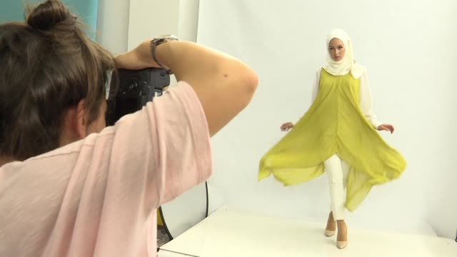 the debate over the burkini has put islamic fashion in the spotlight but covering up doesn't have to mean crimping on style with istanbul angling to... - crimped hair stock videos and b-roll footage
