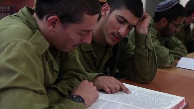 the debate over whether ultraorthodox jews should perform mandatory military service continues to rage in israel especially after lawmakers recently... - israeli military stock videos and b-roll footage