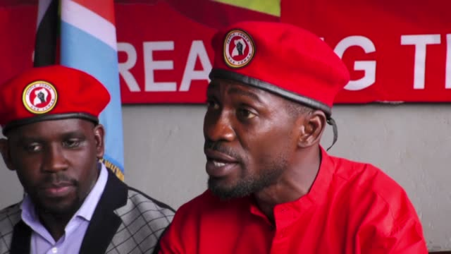 the decision of the ugandan government to inlcude the red beret and tunic in the country's first ever gazette of military clothing effectively bans... - tunic stock videos & royalty-free footage