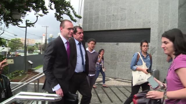 The defense lawyer of Brazil's graft convicted former president Luiz Inacio Lula da Silva handed his passport in to police on Friday after the...