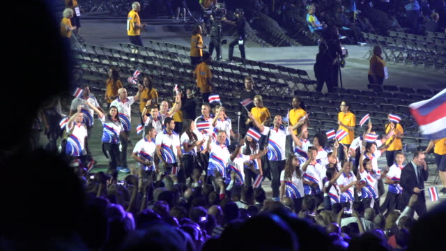the delegation of costa rica entering the stadium the event major performer was cirque du soleil which faced his largest and most complicated... - feierliche veranstaltung stock-videos und b-roll-filmmaterial