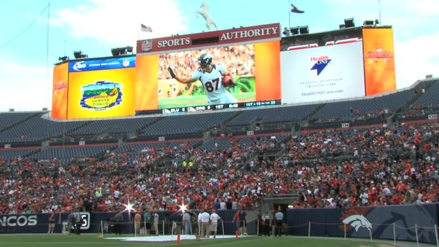 the denver broncos will utilize a new 220feet long 40feet high led video board to enhance the gameday experience at sports authority field at mile... - scoreboard stock videos & royalty-free footage