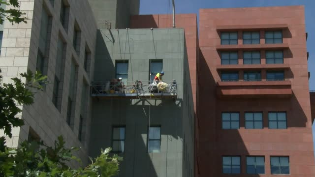 the denver public library's unique stone facade is getting a facelift after 20 years because the caulking between the stones needs to be replaced all... - caulk gun stock videos and b-roll footage