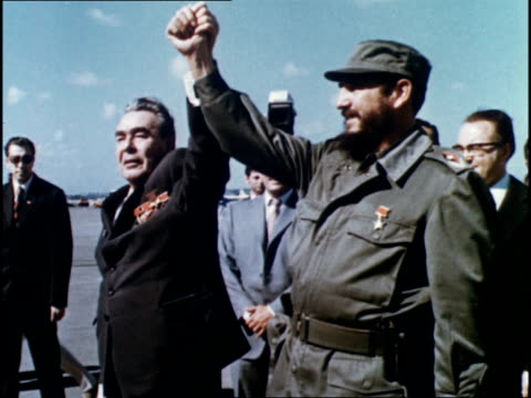 vídeos de stock e filmes b-roll de the departure of brezhnev from cuban airport amidst cheering flag waving cubans / farewells and plane take off - leonid brezhnev