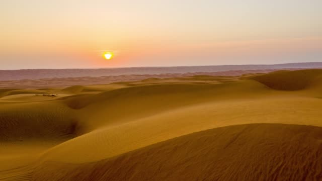 hyperlapse the desert in oman at dawn - sand dune stock videos & royalty-free footage