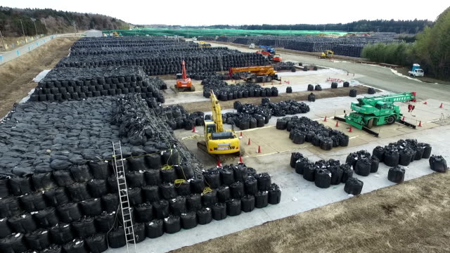 """the """"designated waste"""" including sludge and other radioactive materials from the tokyo electric power company fukushima daiichi nuclear disaster is... - nuclear energy stock videos & royalty-free footage"""
