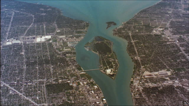 the detroit river flows between detroit and ontario. - michigan stock videos & royalty-free footage