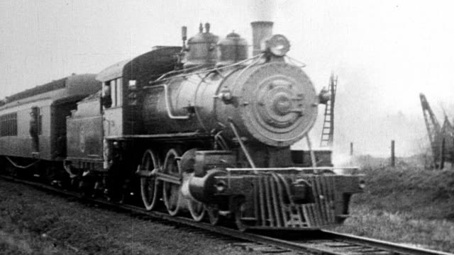 the detroit, toledo and ironton train going down tracks, henry ford driving train - ヘンリー・フォード点の映像素材/bロール