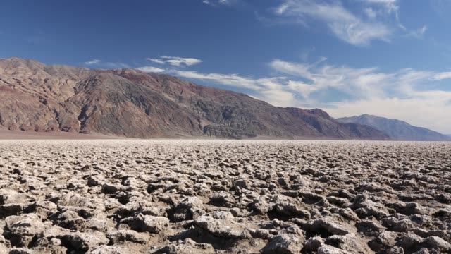 the devils golf course in death valley which is the lowest, hottest, driest place in the usa, with an average annual rainfall of around 2 inches, some years it does not receive any rain at all. - death valley national park stock videos & royalty-free footage