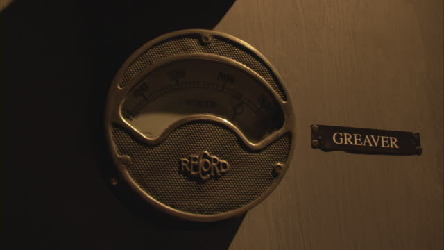 The dial of an antique electric voltmeter rises and falls with the use of a light dimmer.