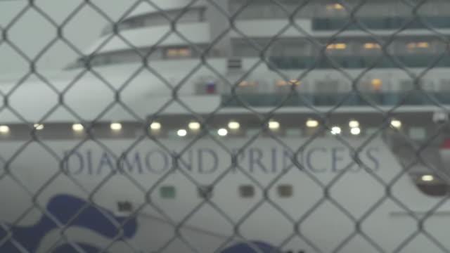 the diamond princess cruise ship, held in quarantine over coronavirus contamination, coming into focus - moored stock videos & royalty-free footage
