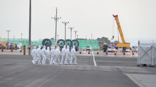the diamond princess cruise ship, operated by carnival corp., sits docked in yokohama, japan, on friday, february 7, 2020. japan confirmed 41 more... - クリーンスーツ点の映像素材/bロール