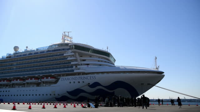 the diamond princess cruise ship sits docked at daikoku pier where it will be resupplied and newly diagnosed coronavirus cases taken to hospital as... - aomori prefecture stock videos & royalty-free footage