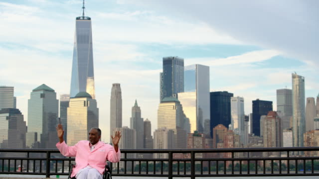 vídeos de stock e filmes b-roll de the disabled afro-american black veteran traveling in america, visiting liberty state park in new jersey. - new york state